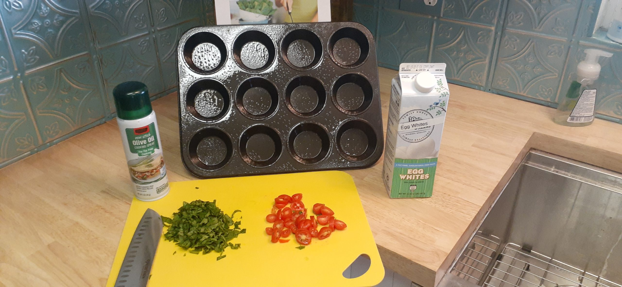 Ingredients cherry tomatoes baby spinach egg whites and 12 count muffin pan
